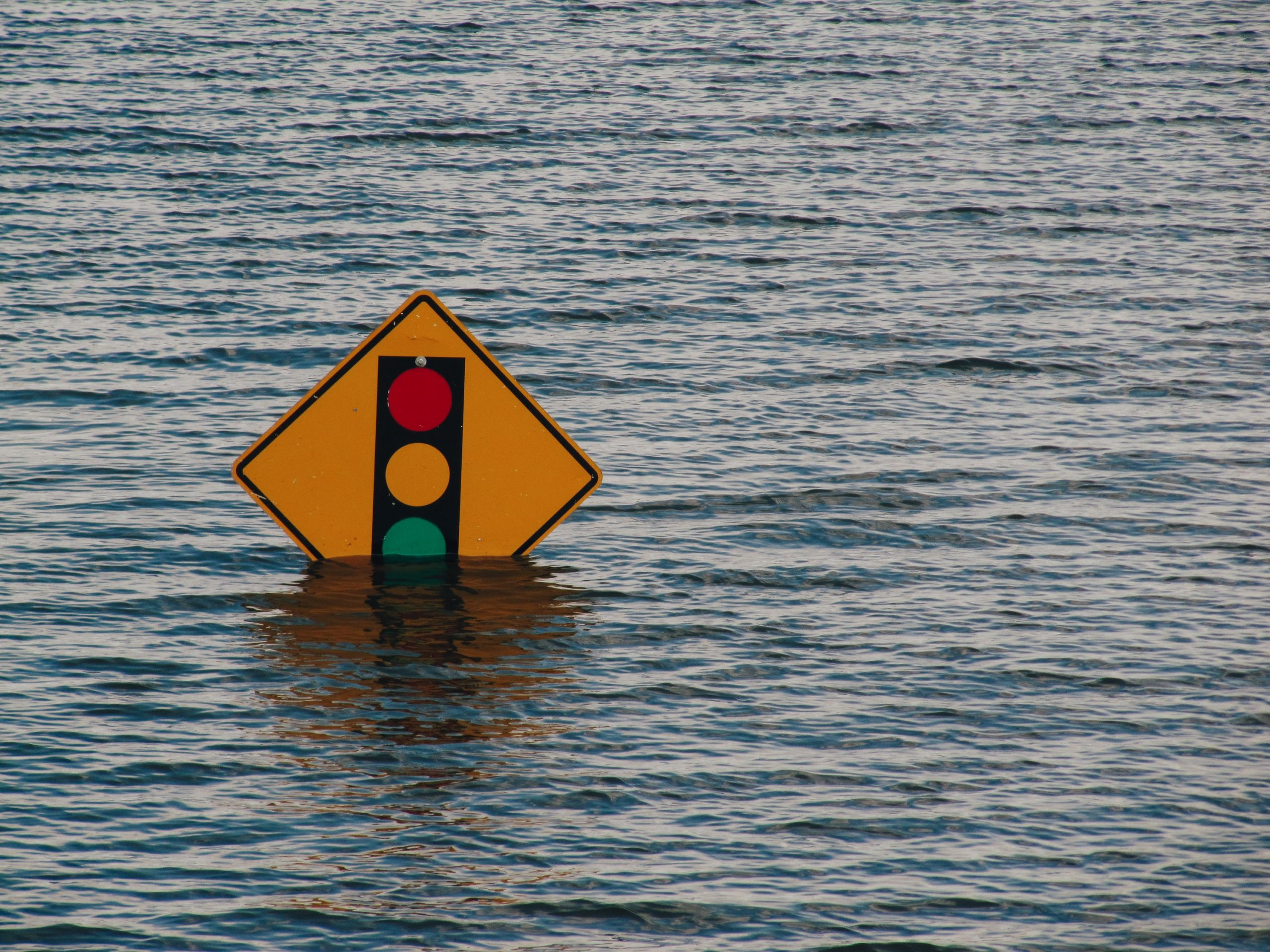 Street sign underwater with flooding